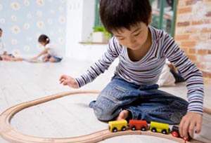 child playing with trains