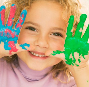 girl with paint hands