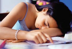 teen sleeping at desk
